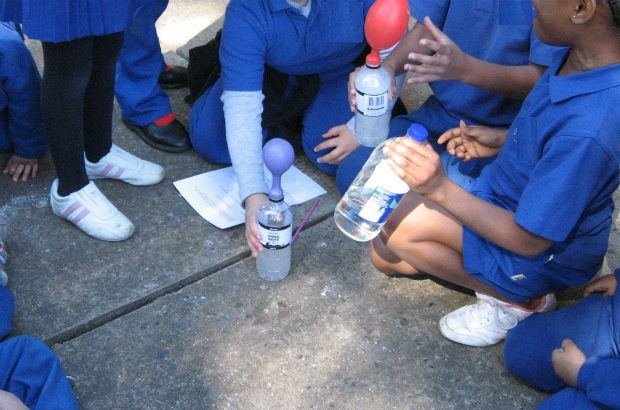 School children conducting science experiment