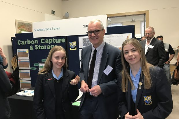 Government Chief Scientific Adviser Sir Patrick Vallance posing with schoolchildren at the Industrial Strategy Science Fair.