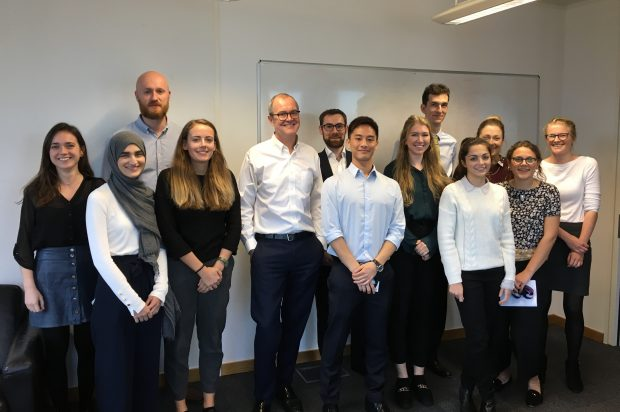 Sir Patrick Vallance poses for a group photo with interns.