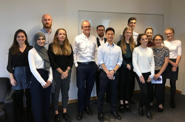 Sir Patrick Vallance poses for a group photo with interns