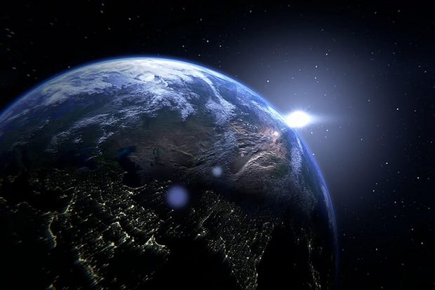 image shows earth with a flash of light behind