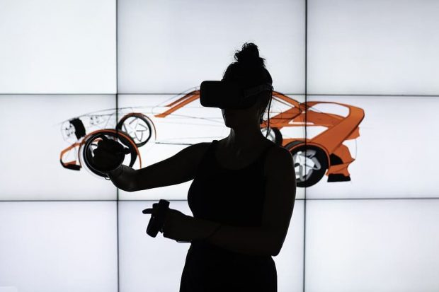 Image shows a women with vr equipment