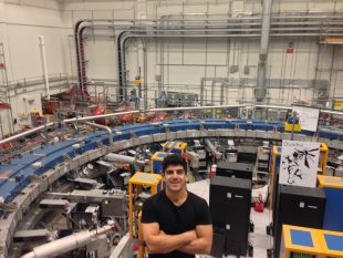 Dr Alex Keshavarzi next to the muon g-2 ring in the Fermilab.