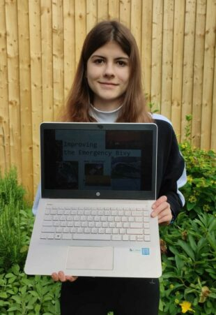 Amy Greener Showing her project on her laptop